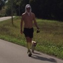 VS500K-RR - Joshua Holmes in Wartace, TN being followed by a dog - Vol State 500K