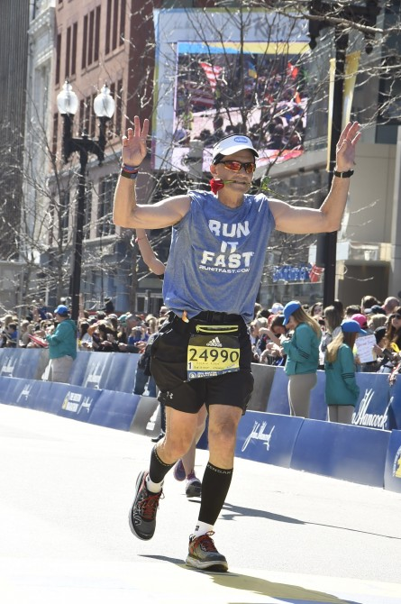 Robin Robbins Finishing the Boston Marathon with Rose